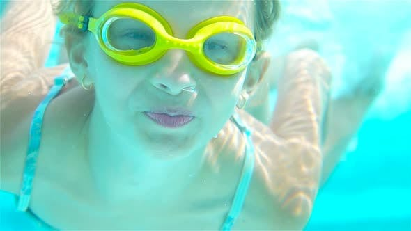 Thumbnail for The Little Girl in the Swimming Pool Underwater and Smiling