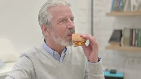 Thumbnail for Hungry Old Man Eating Cheese Burger