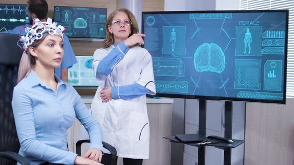 Cover Image for Focused Female Neuroscientist Making Hand Gestures