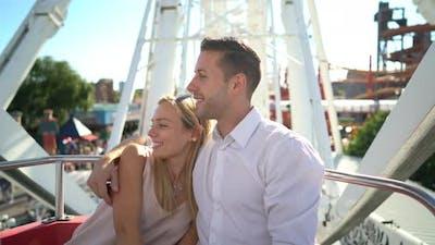 Couple in Big Wheel of Amusement Park