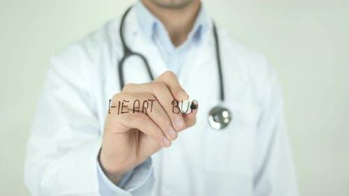 Heart Burn, Doctor Writing on Transparent Screen