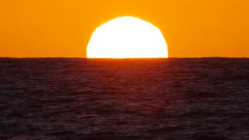 Sun Over the Sea The Concept of Sunset or Dawn Sunlight Shines Through the Ocean Waves