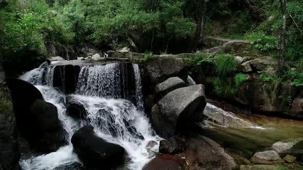Thumbnail for View of Waterfall Scenes in Mountains