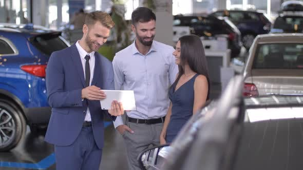 Couple Interested To Buy Car at Showroom