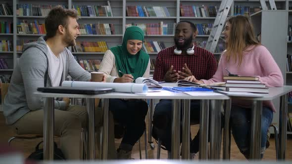 Cover Image for Multiracial Students Doing Group Study in Library