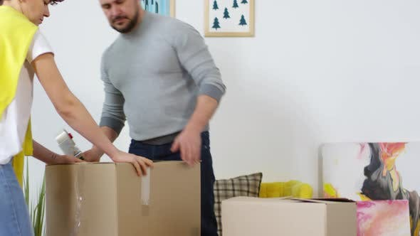 Thumbnail for Caucasian Couple Putting Things Away for Storage