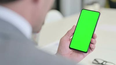 Businessman Using Smartphone with Green Chroma Screen