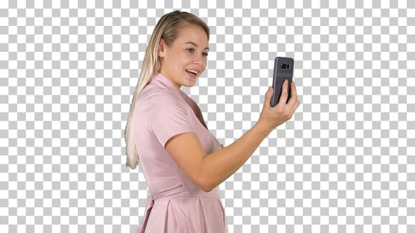 Female in pink dress making video call, Alpha Channel