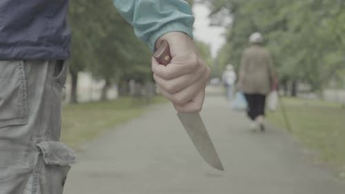 Maniac with a Knife in His Hand