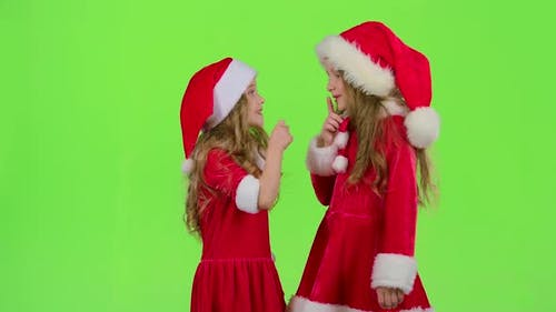 Baby of the Assistant Santa Claus Say Quietly To Their Elves. Green Screen