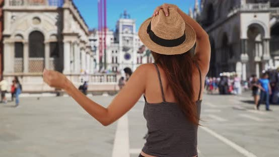 Thumbnail for Young joyful tourist woman in Venice twirling on streets in St. Mark's Square