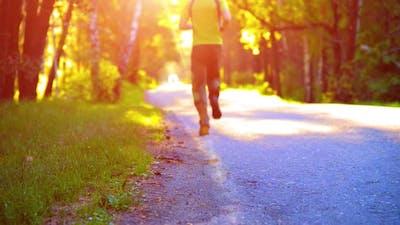 Sport Man Running at Asphalt Road