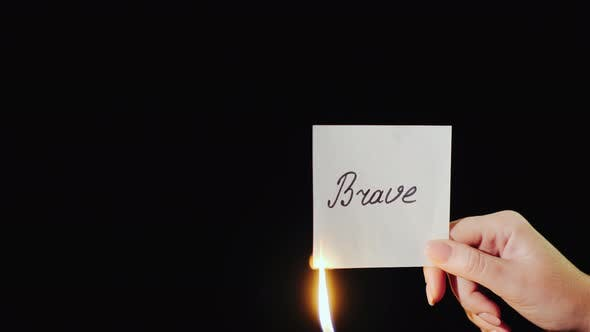 Thumbnail for Man Burns a Paper with the Inscription Brave