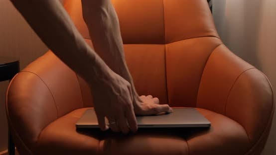 Unrecognizable man turning off and shut down a laptop with pre-keyed green screen