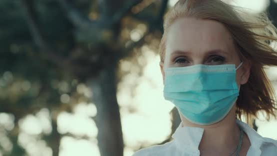 The Woman Removes the Medical Mask and Sighs Freely