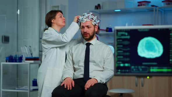Patient with Brain Scan Discussing with Researcher Neurological Doctor