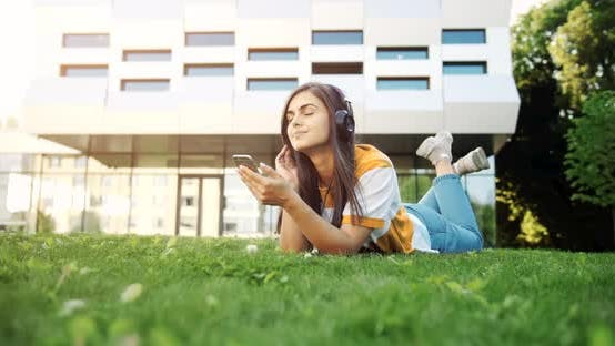 Thumbnail for Hipster Woman Listening To Music in Headphones