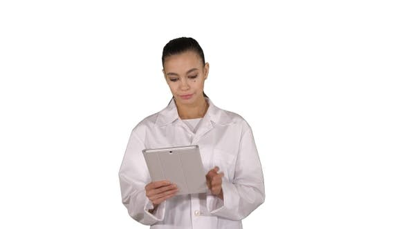 Thumbnail for Doctor using tablet while walking on white background.