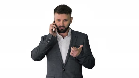 Thumbnail for Business Man with a Beard Making a Serious Call on White Background