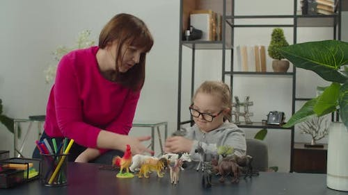 Child with Disability and Mom Involved in Cognitive Game