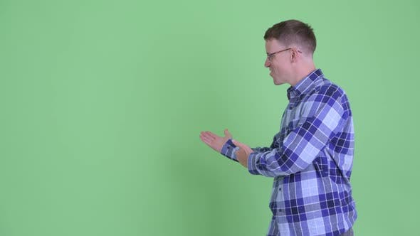 Cover Image for Portrait of Happy Hipster Man Showing To Back and Giving Thumbs Up