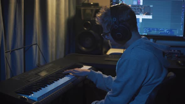 Thumbnail for Teenager at Home Composes Music In His Home Sound Studio