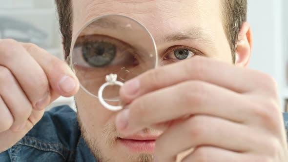 Thumbnail for Examining Ring Through Loupe