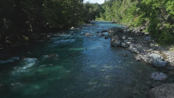 Thumbnail for Drone Over Turquoise River In Forest