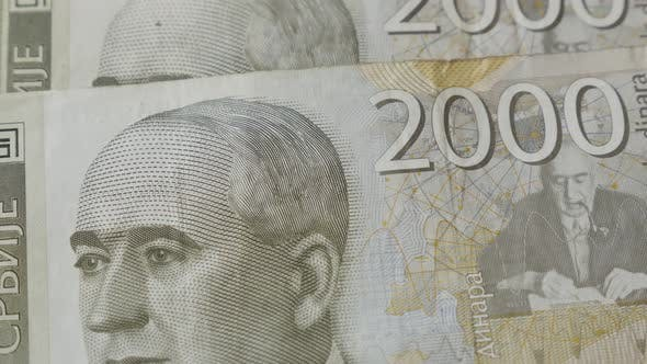 Thumbnail for Tilting on Serbian currency dinar in 2000 denominations on pile 4K 2160p 30fps UltraHD footage - Off
