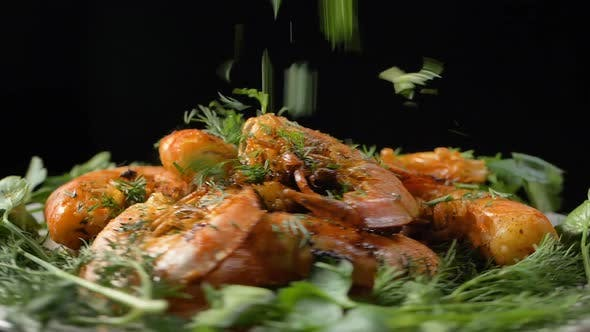 Thumbnail for Dill Falls Down Onto Tasty Grilled Shrimps Turning on Table