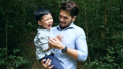 Dad and son have a happy time at the nature.