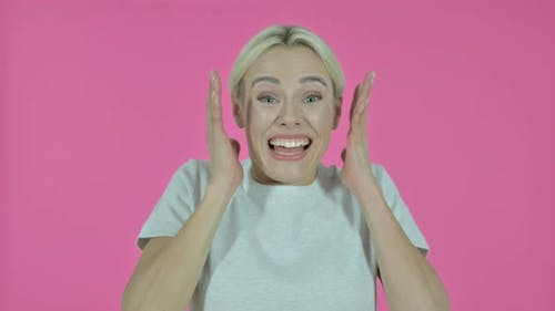 Shocked Young Woman Wondering on Pink Background