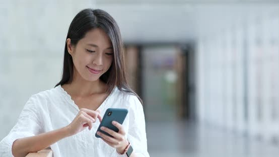 Thumbnail for Woman use of cellphone in campus