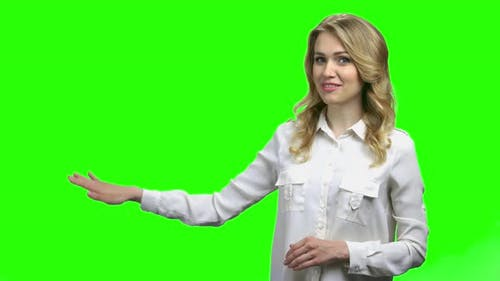 Young Charming Woman Presenting Something on Green Screen