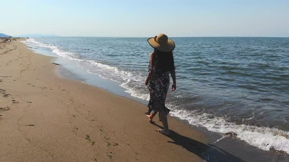 Thumbnail for Girl Walking at the Seaside