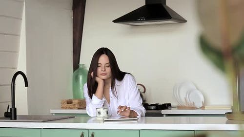 Girl using tablet in the kitchen