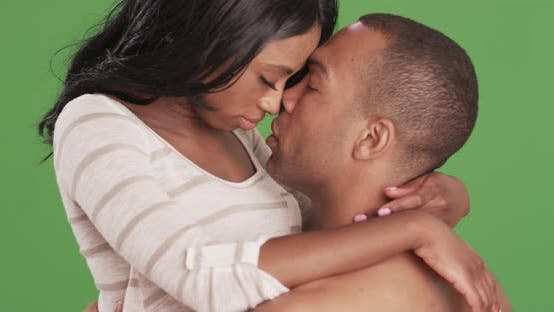 Thumbnail for Black couple kissing and embracing on green screen