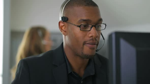 Businessman talking with headset in office