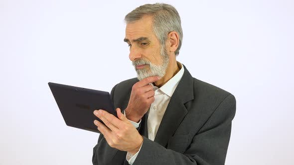 Thumbnail for An Elderly Man Works on a Tablet with a Smile - White Screen Studio