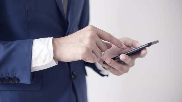 Thumbnail for Businessman Playing Smartphone