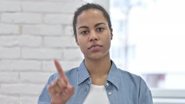 Cover Image for Rejecting Young African Woman, No with Finger Sign