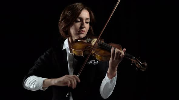 Thumbnail for Girl in Play the Violins in a Room. Black Background