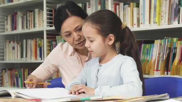 Thumbnail for Cute Little Girl Doing Homework with Her Mother