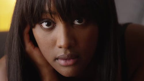 Sultry black woman looking at camera