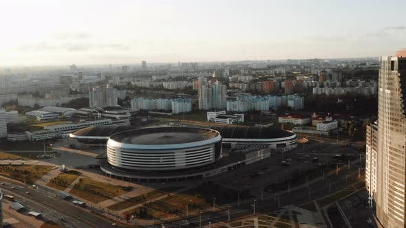 Thumbnail for Drone Flying Around Minsk Arena City Stadium, Urban Panorama of Belarus During Majestic Sunrise on