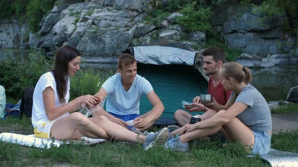 Thumbnail for Group of Tourists Eating Snack and Camping in Wild