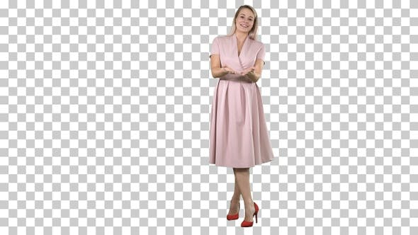Thumbnail for Happy blonde woman in pink talking to camera and pointing to