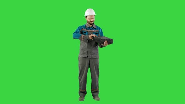 Thumbnail for Handyman Prepared for Any Eventuality Shows Tools on Camera on a Green Screen, Chroma Key.