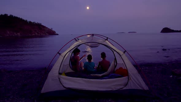 Thumbnail for Mom with Children Near the Tent at Night