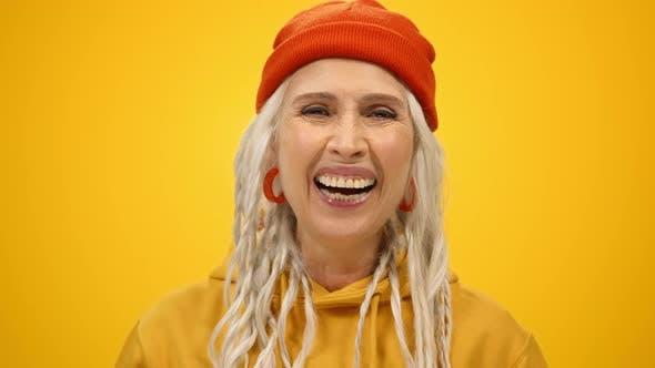 Cheerful Elderly Woman Posing in Studio